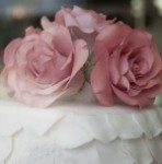 Cake top - iced with pink flowers